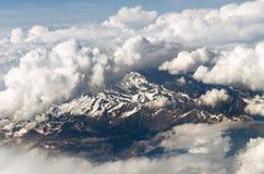 Montagne vedute da un aeroplano Immagini Stock