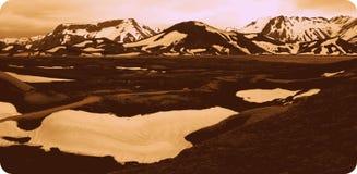 Montagnes avec la neige avec une lueur 2 Photographie stock libre de droits