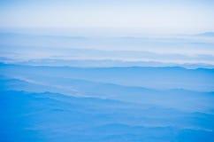 Montagnes dans le ciel Images stock