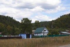 Montagnes de village de photo Photos stock
