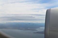 Montagnes en verre de Chambre d'avion Photographie stock