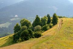 Montagnes et route de matin Images libres de droits