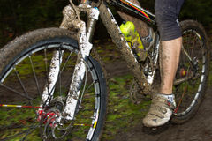Montainbiker in mud Stock Photo