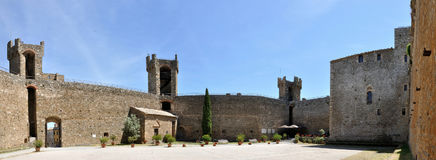 Montalcino castle inside panorama. Montalcino rises in the heart of southern Tuscany. In the Middle Age the territory of Montalcino was divided between four Stock Photos