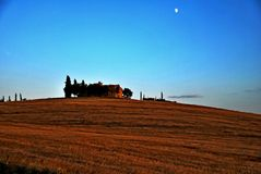 Montalcino. Tuscany Italy square  sky windows cloud tower colors country road street courts green door panorama Stock Photo