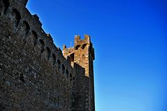 Montalcino. Tuscany Italy square  sky windows cloud tower colors country road street courts green door panorama monument church castle Royalty Free Stock Photography