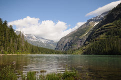 Montana Avalanche Lake. Remote alpine lake with mountain glacier in background royalty free stock photography
