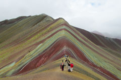 Montana De Siete Colores near Cuzco. Seven colour mountain in Peru. Tourists climbing to the top Royalty Free Stock Photography