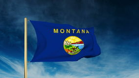 Montana flag slider style. Waving in the win with. Montana flag slider style. Waving with cloud background animation stock footage