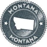Montana map vintage stamp. Retro style handmade label, badge or element for travel souvenirs. Dark blue rubber stamp with us state map silhouette. Vector royalty free illustration