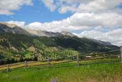 Montana Mountain Range. With fence and pasture royalty free stock image