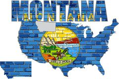 Montana på en tegelstenvägg Arkivfoto