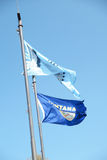 Montana state flag and Blackfeet Flag fly together. Stock Image