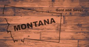 Montana Map Brand. Montana state map brand on wooden boards with map outline and state motto vector illustration