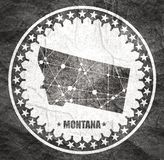 Montana state map. Image relative to USA travel. Montana state map textured by lines and dots pattern. Stamp in the shape of a circle royalty free illustration