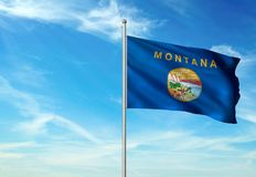 Montana state of United States flag waving blue sky background realistic 3d illustration. Montana state of United States flag on flagpole waving blue sky vector illustration