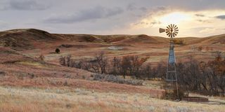 Montana Windmill at Sunset Royalty Free Stock Image
