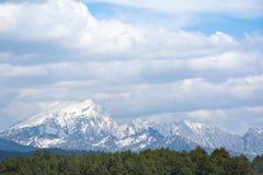 Montanha c?nico da neve na montanha da neve de Jade Dragon, Lijiang, China foto de stock royalty free