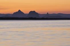 Montanhas da estufa no por do sol Fotos de Stock Royalty Free