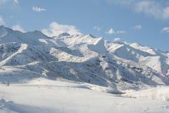 Montanhas v3 da neve Imagens de Stock