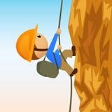 Montanhista de rocha dos desenhos animados no cliffside vertical Fotografia de Stock Royalty Free