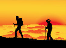 Montanhistas do por do sol Fotografia de Stock