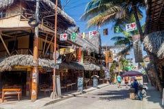 MONTANITA, ECUADOR - JUNE 30, 2015: Montanita village is full of restaurants, bars and hostel stock photos