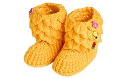 Montantes feitos malha, amarelos para crianças Foto de Stock Royalty Free