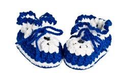 Montantes feitos malha, azuis para crianças Fotografia de Stock Royalty Free