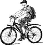 Montar a caballo adolescente una bicicleta Imagenes de archivo
