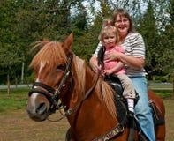 Montar a caballo de la abuela y de la nieta Fotografía de archivo libre de regalías