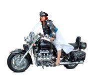Montar una motocicleta Imagen de archivo libre de regalías