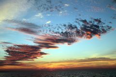 Montauk. Clouds line the sky at sunset in Montauk, New York Royalty Free Stock Photography