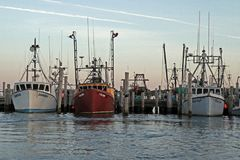 Montauk. Fishing boats are seen at dusk in Montauk, New York Royalty Free Stock Images
