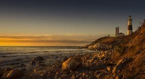 Montauk Lighthouse During Sunrise. Montauk Lighthouse resting on the edge of the coast during the golden sunrise Royalty Free Stock Images
