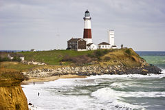 Montauk Point Lighthouse and two fishermen Stock Image