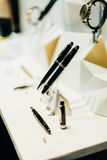 Montblanc fountain pens and luxury male watches Stock Images
