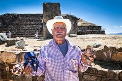 Unknown old man selling mayan mask, at Monte Alban ancient Zapo royalty free stock photo