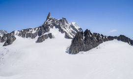 Monte Bianco massif in Alps ,Courmayeur ,Aosta Valley ,Italy. Pointe Helbronner mountain - 3462 m, Monte Bianco massif in Alps (Mont Blanc), Courmayeur ,Aosta Royalty Free Stock Images
