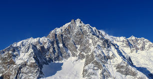 Monte Bianco. Snow covered mountain peak, Monte Bianco taken in Italy during the winter Royalty Free Stock Photos