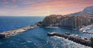 Monte Carlo city panorama with luxury yachts in harbor during sunset, Cote d'Azur.aerial view cityscape. Skyscrapers, marina. Royalty Free Stock Image