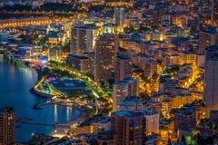 Monte - carlo i sikt av Monaco på natten på Cotet d'Azur Royaltyfri Bild