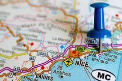 Monte Carlo on map. Close up shot of Monte Carlo, Monaco, Nice Cannes, Menton, Antibes on map with blue push pin royalty free stock photo
