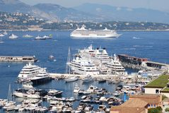Monte-Carlo, marina, passenger ship, water transportation, cruise ship. Monte-Carlo is marina, cruise ship and port. That marvel has passenger ship, ship and royalty free stock image