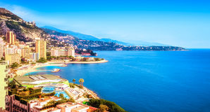 Monte Carlo and the mediterranean sea. Aerial view of the Grimaldi Forum, the Larvotto district, the beautiful blue color of the mediterranean sea extending all Stock Photos