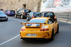Luxury Yellow Porsche 911 GT3 Rear View. Monte-Carlo, Monaco - April 21, 2018: Luxury Yellow Porsche 911 GT3 Rear View In The Street Of Monaco On The French Royalty Free Stock Images