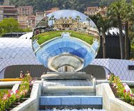 Monte-Carlo, Monaco – August 3, 2013: casino reflected in a sky mirror. In the square opposite stock photos