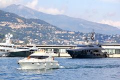 Monte Carlo. MONACO - AUGUST 2, 2014: Luxury yachts at the background of the city architecture Stock Photos