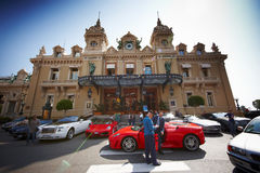 Monte-Carlo, Monaco, Casino Monte-Carlo, 25.09.2008. Casino de Monte Carlo, a young man in white glasses gets out of the red Ferrari and gives car keys to the Stock Photography