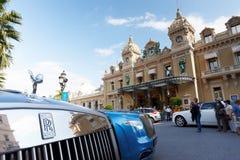 Monte-Carlo, Monaco, Casino Monte-Carlo, 25.09.2008: new Rolls Royce. Casino Monte-Carlo through the of a new Rolls Royce, sunny day, clouds Stock Photography